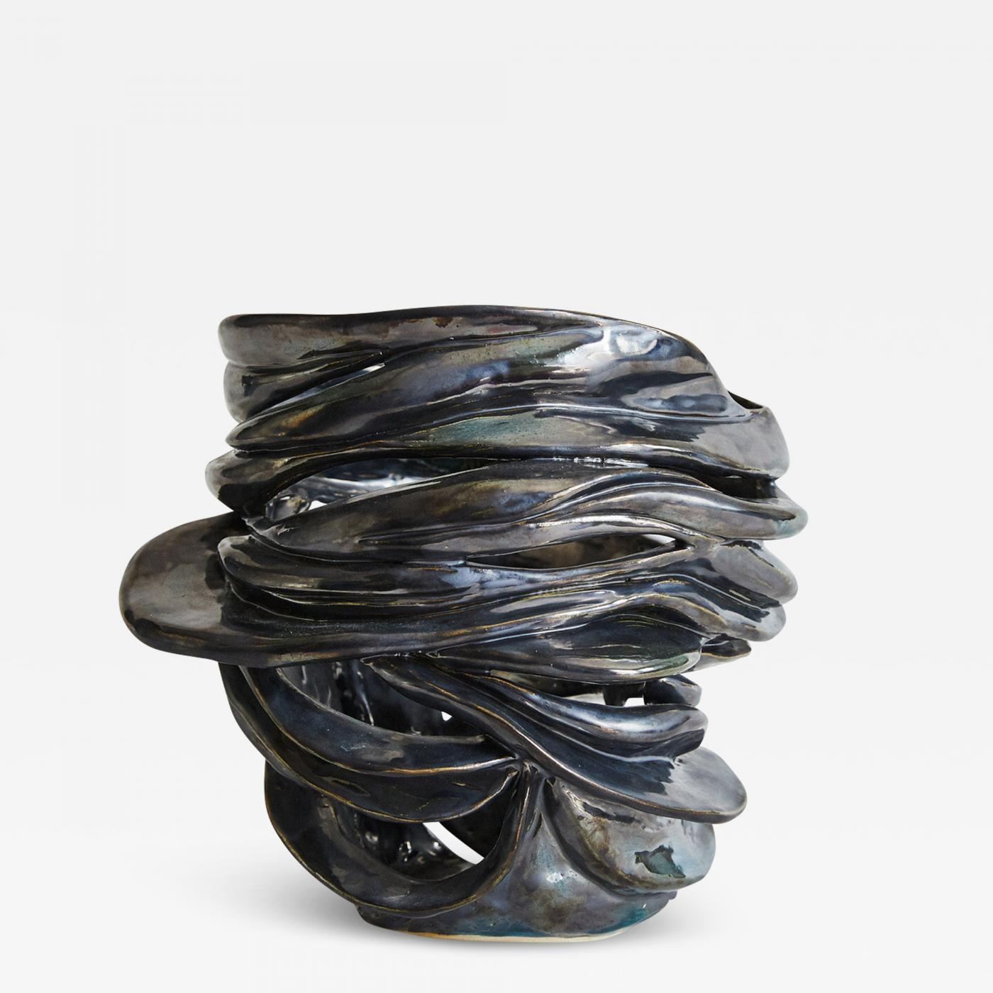 Hand-carved biomorphic vessel in white stoneware with a steel glaze. Signed: RP.