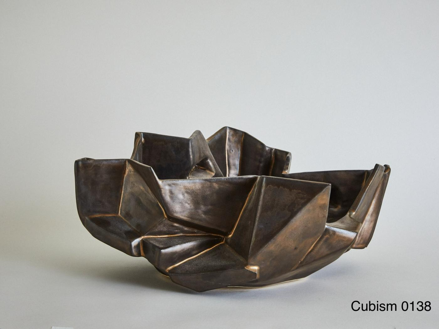 Wheel-thrown and manipulated cubist low vessel.