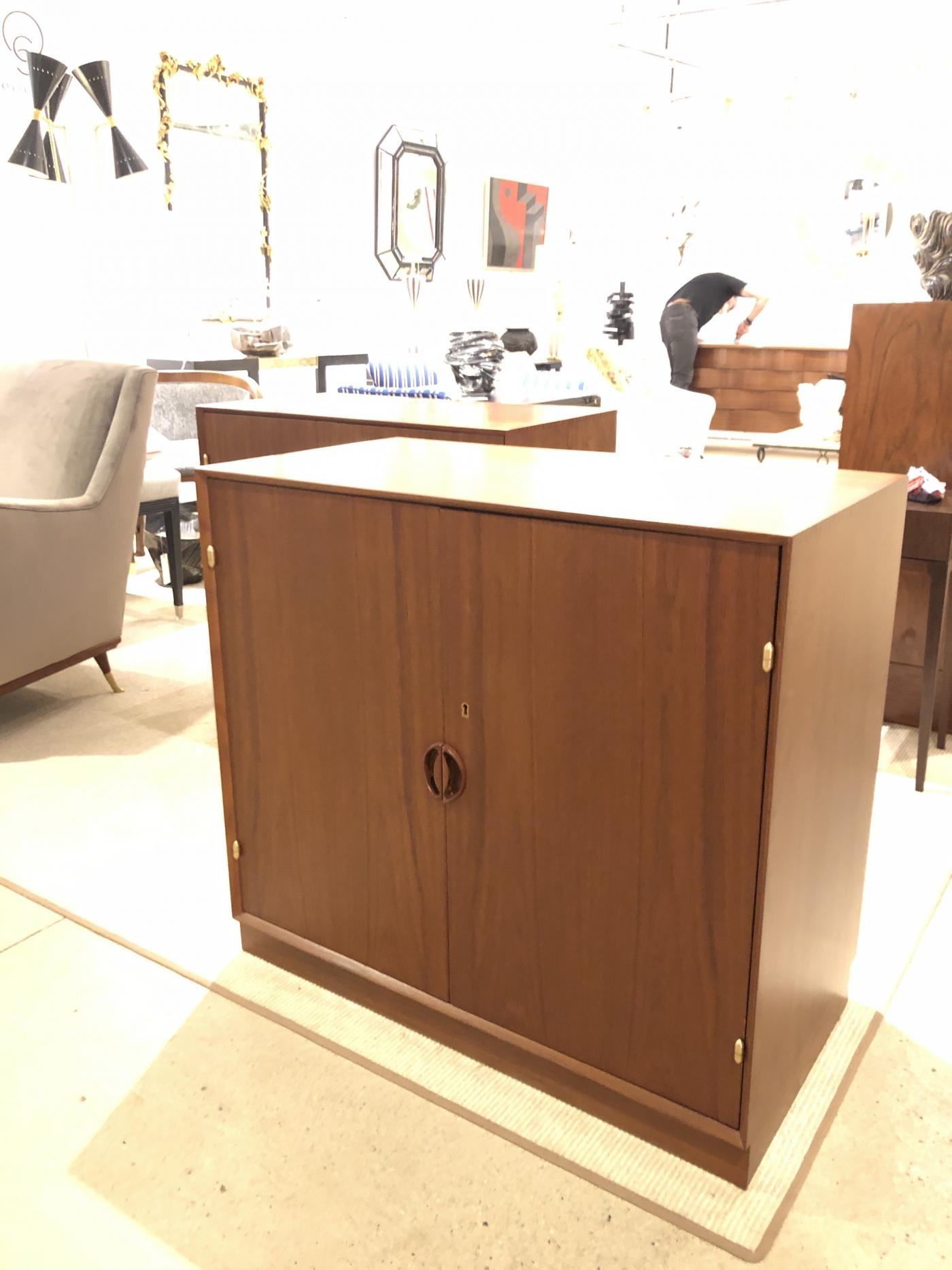 Pair of Mid Century Cabinets by John Stuart Inc. Stamped .