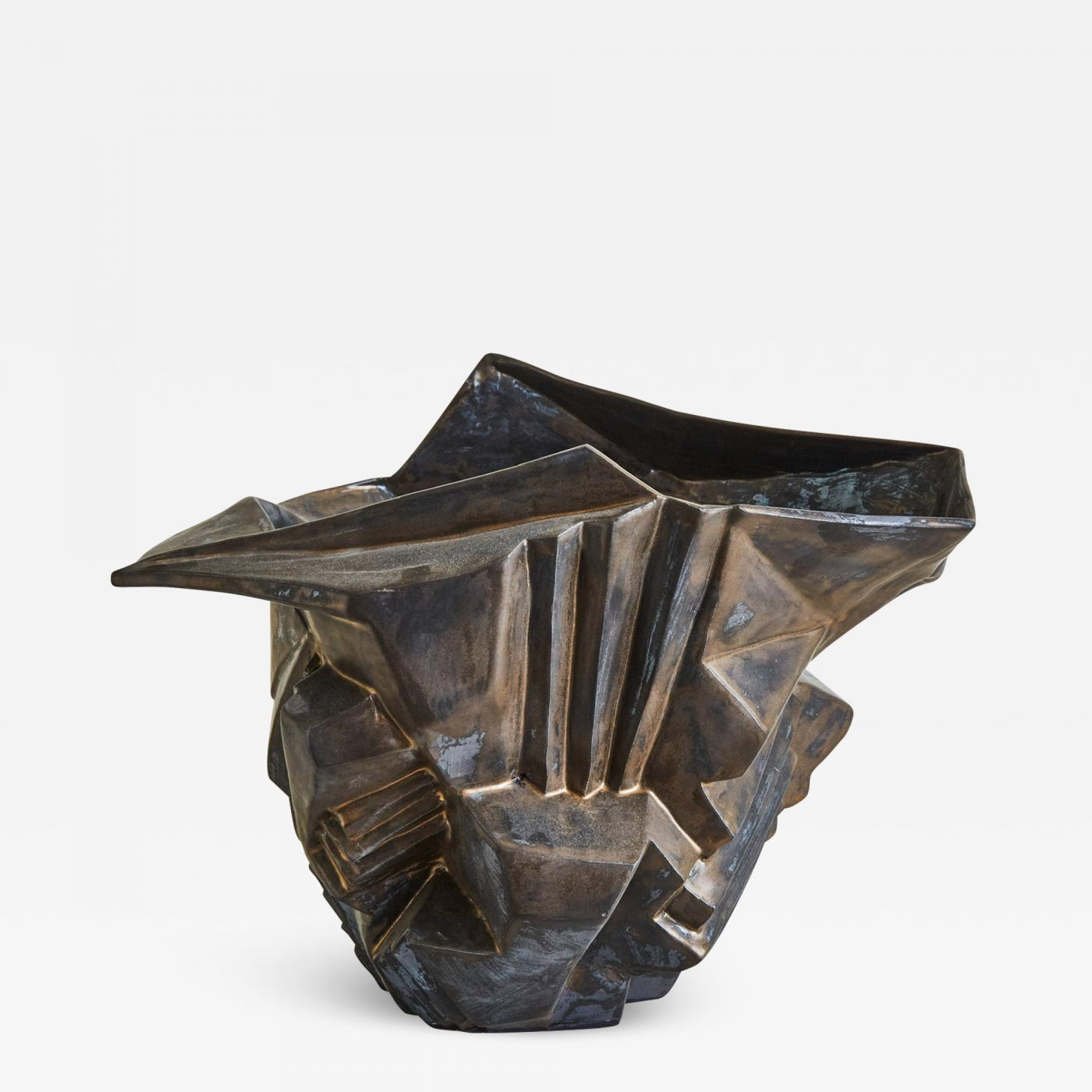 Wheel-thrown and manipulated cubist vessel in white stoneware.