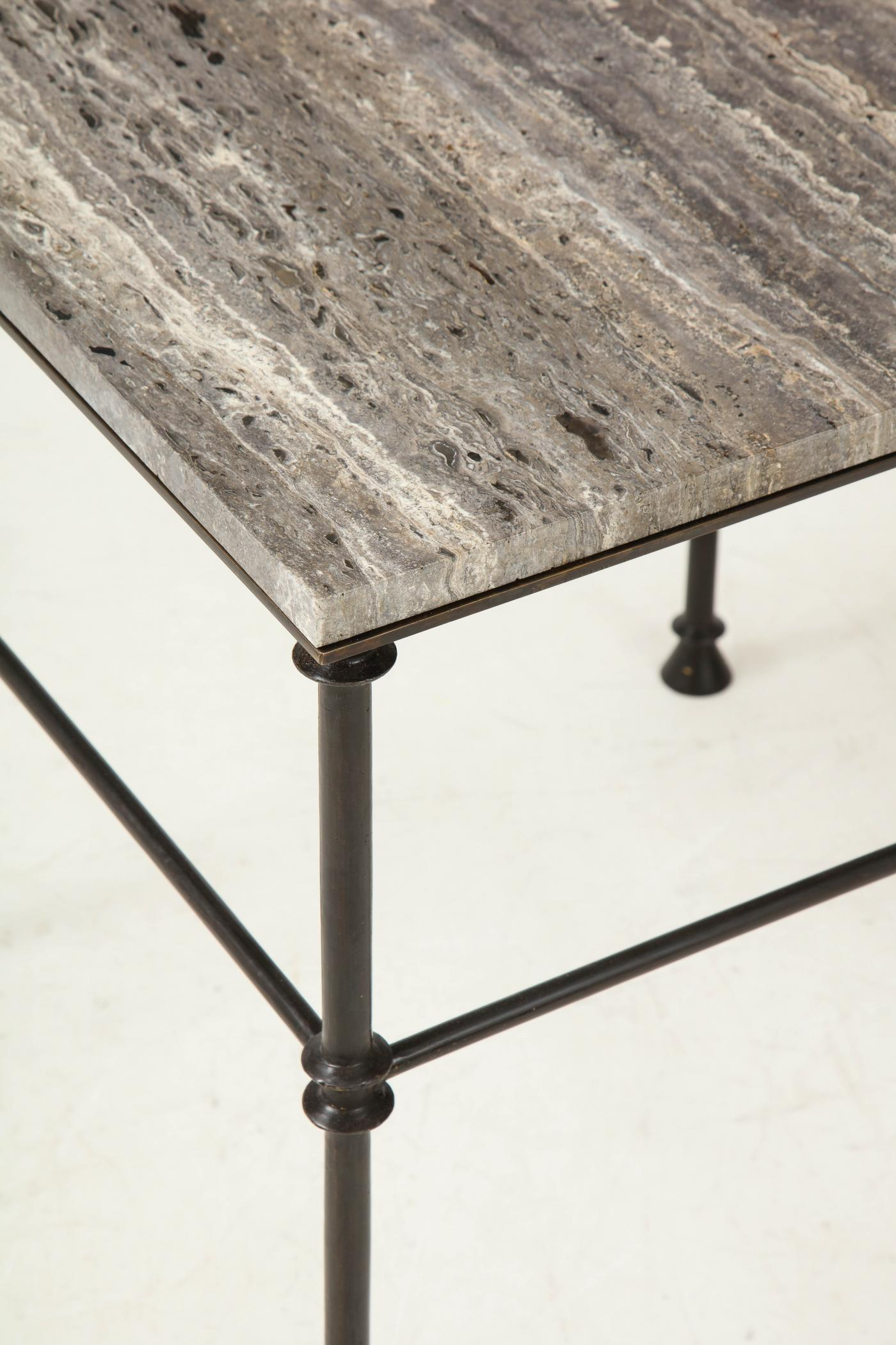 A pair of custom made tables, bronze legs and