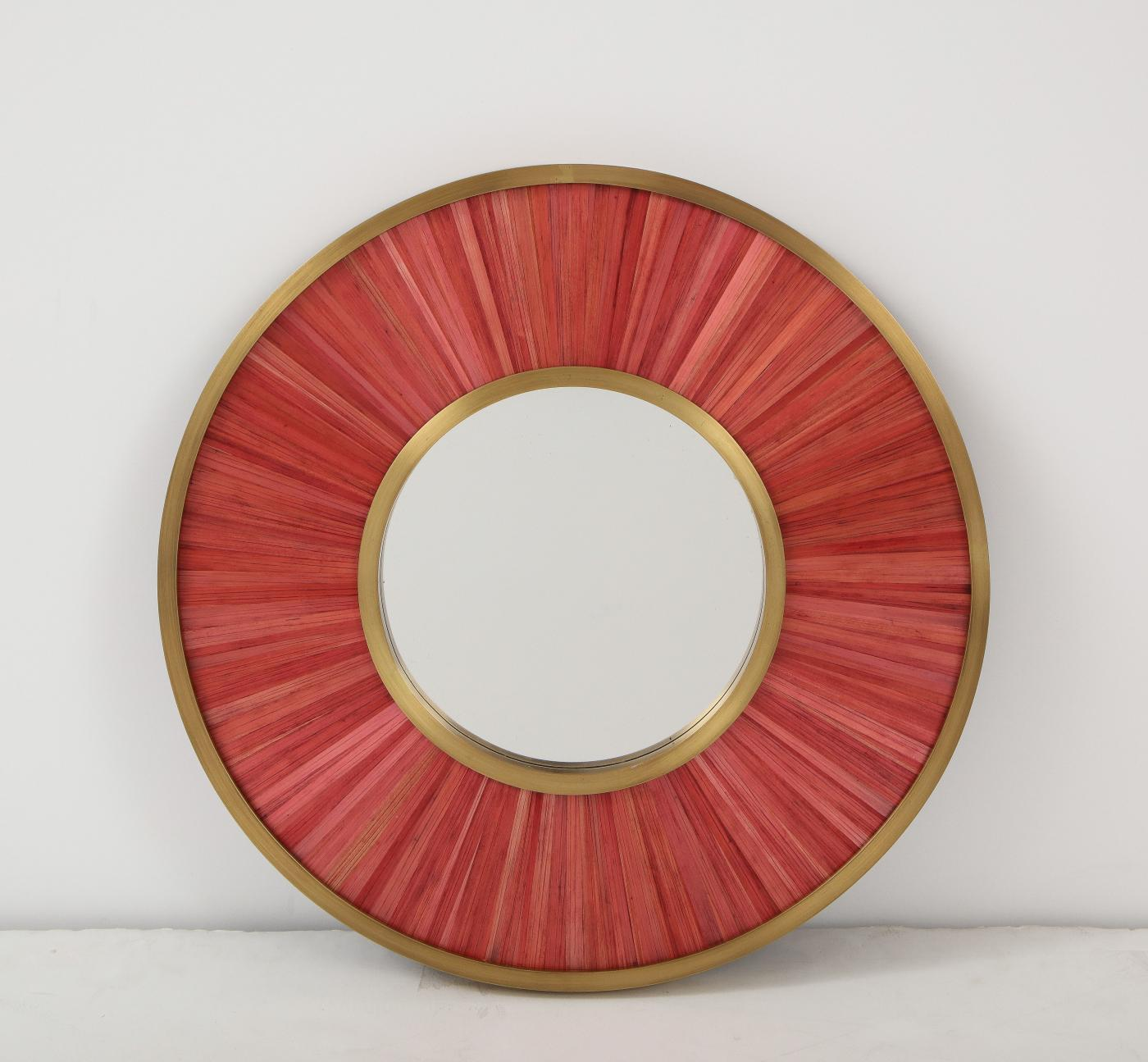 Modernist mirror. Executed in straw marquetry and solid brass frame.