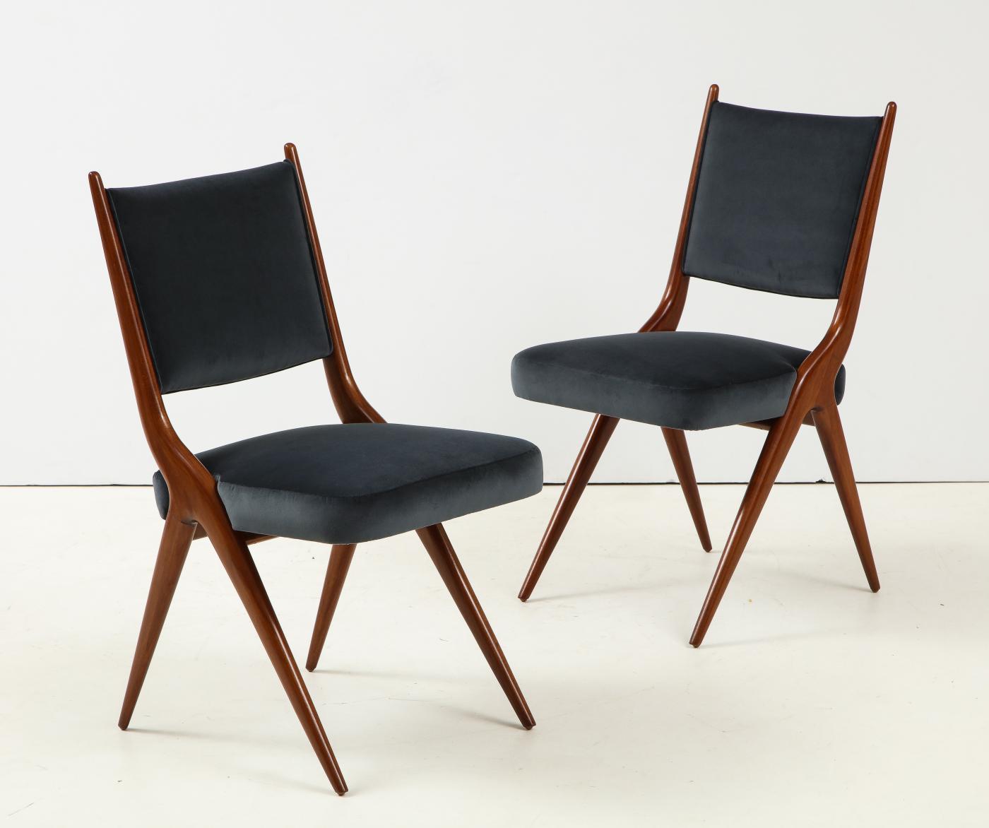 A set of Six mid century modern dining chairs. Solid Italian Walnut.