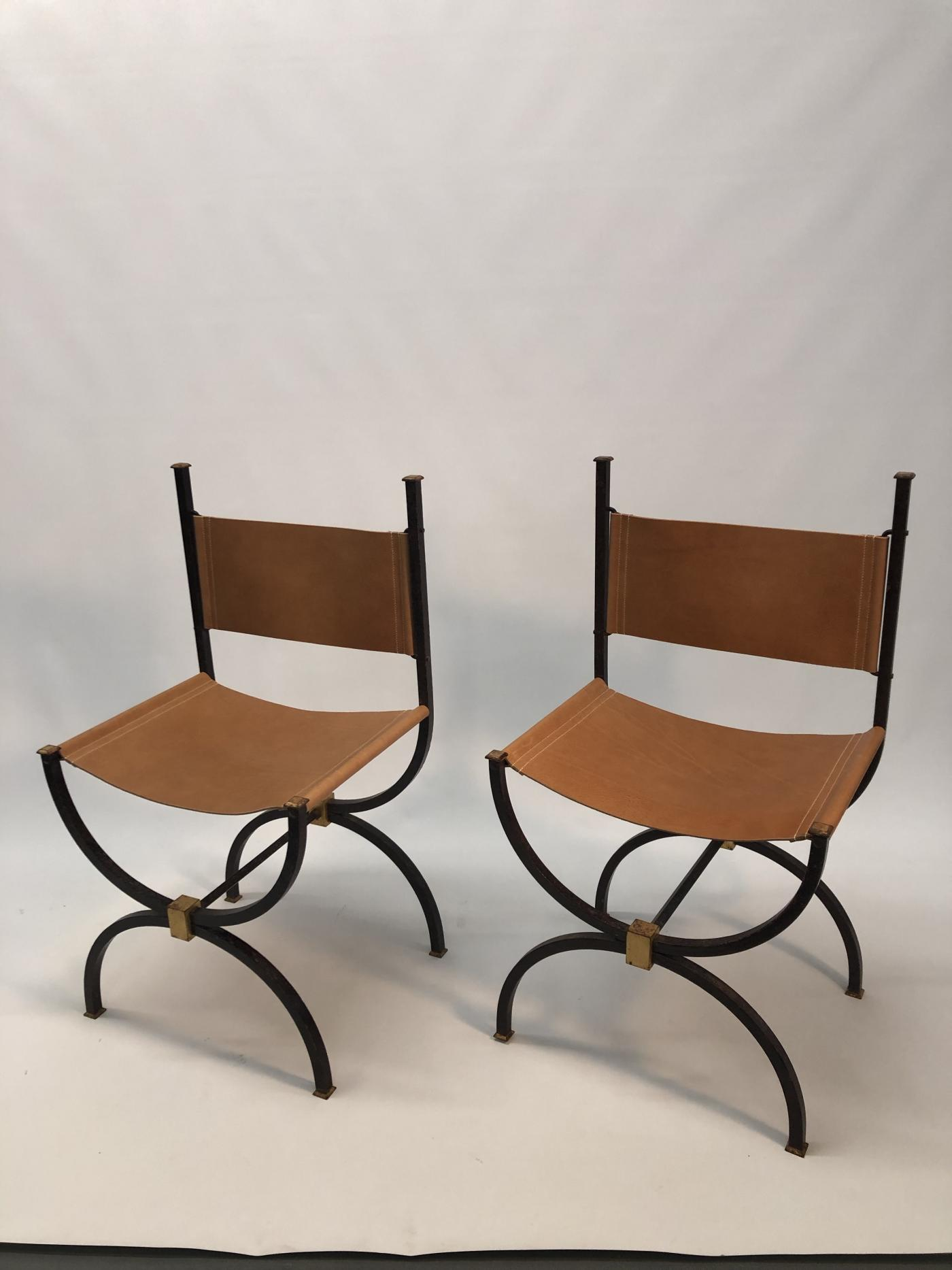 Pair of French Iron side chairs.