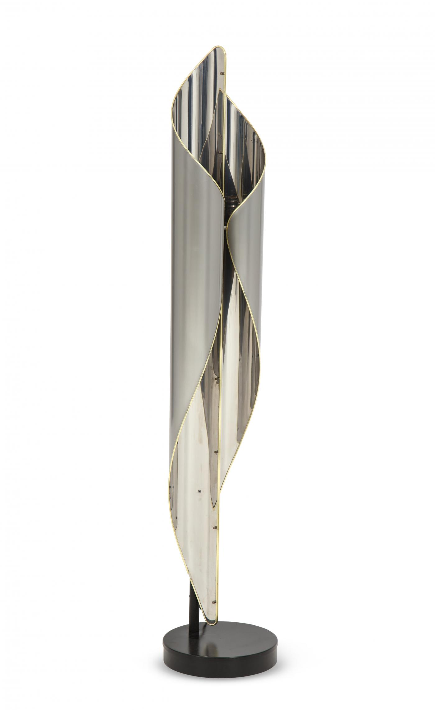 Floor lamp in chrome and steel combined with Brass details.