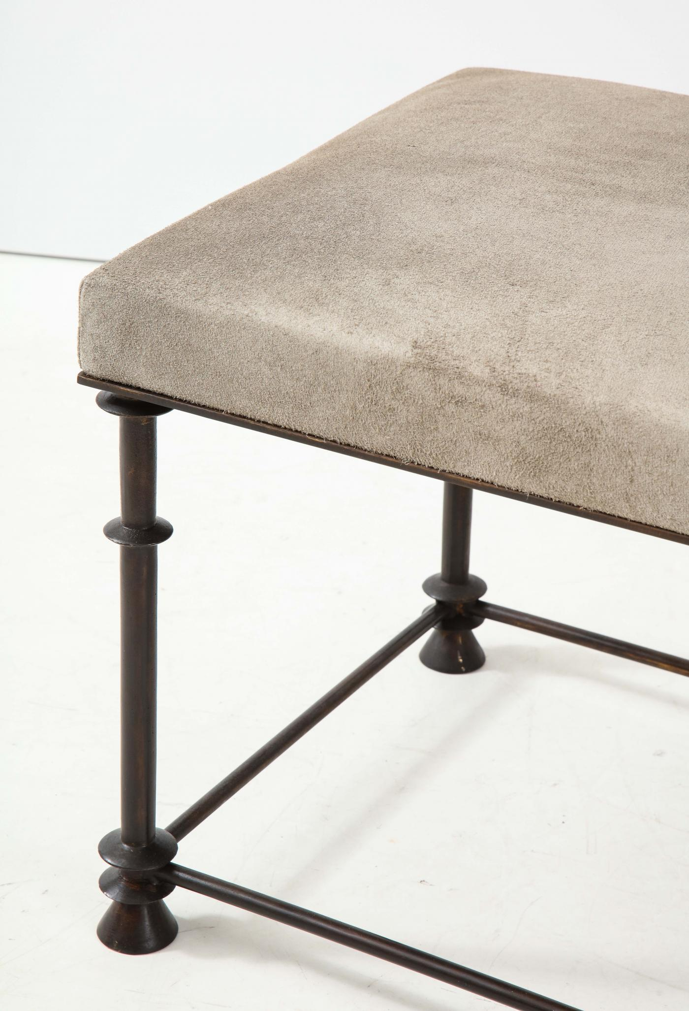 An elegant bronze stool covered with