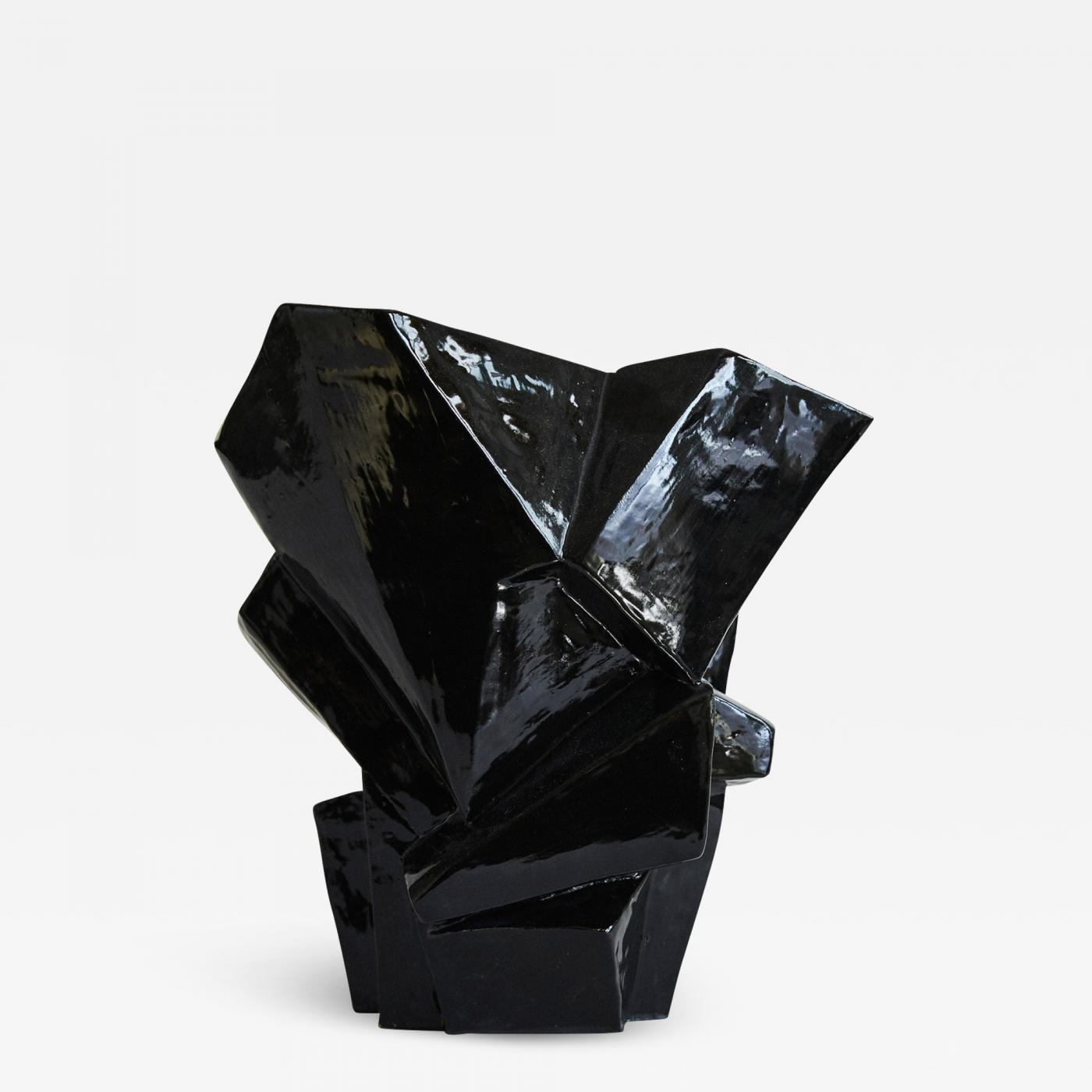 Wheel-thrown and manipulated cubist vessel.