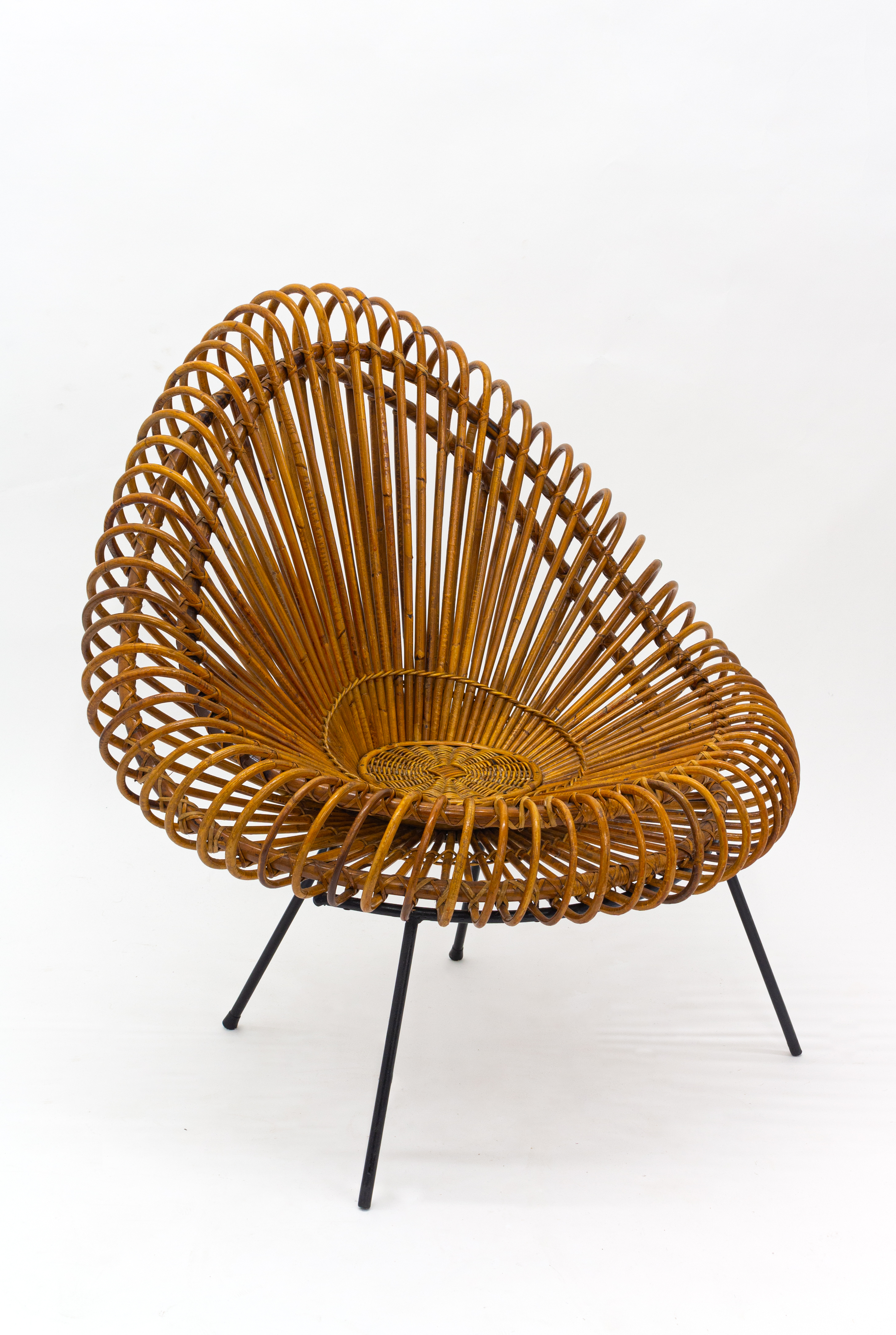 A stylish rattan and iron chair designed by Janine Abraham.