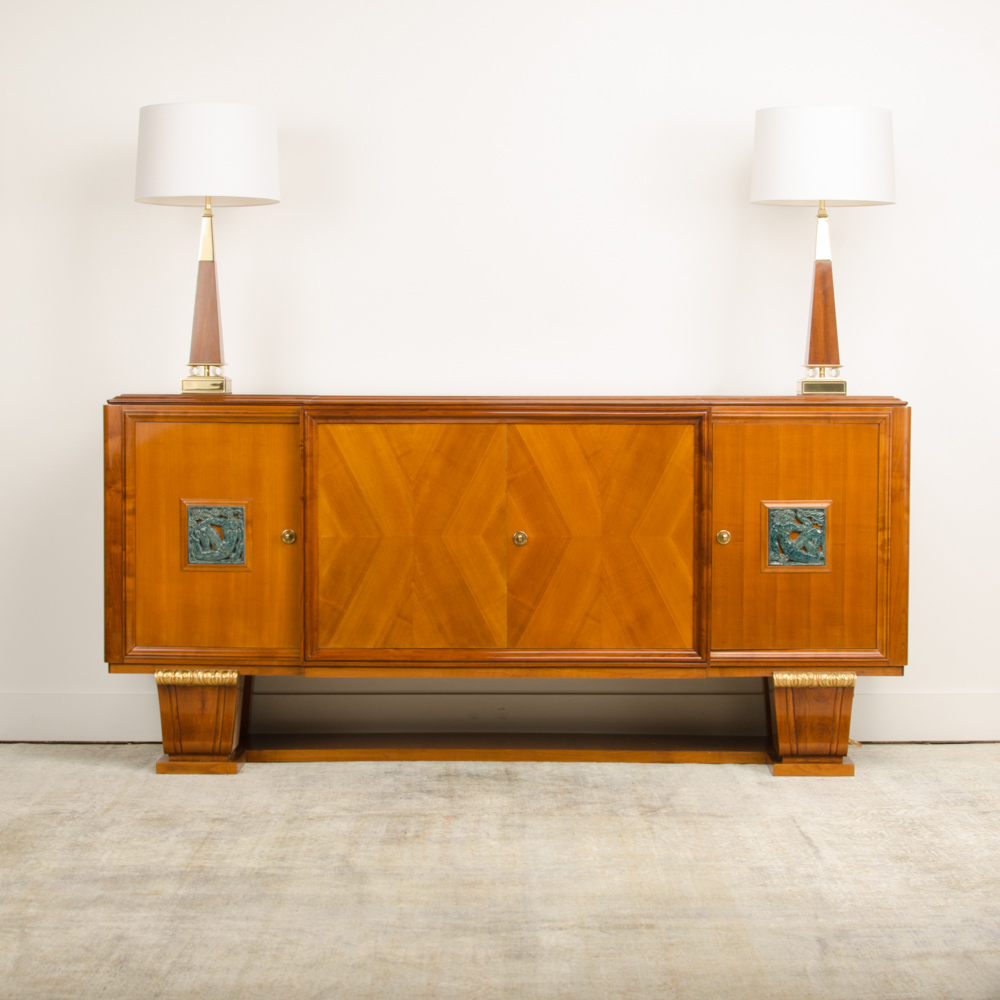 A fine French 1940's walnut veneer with gilded carved wood details sideboard.