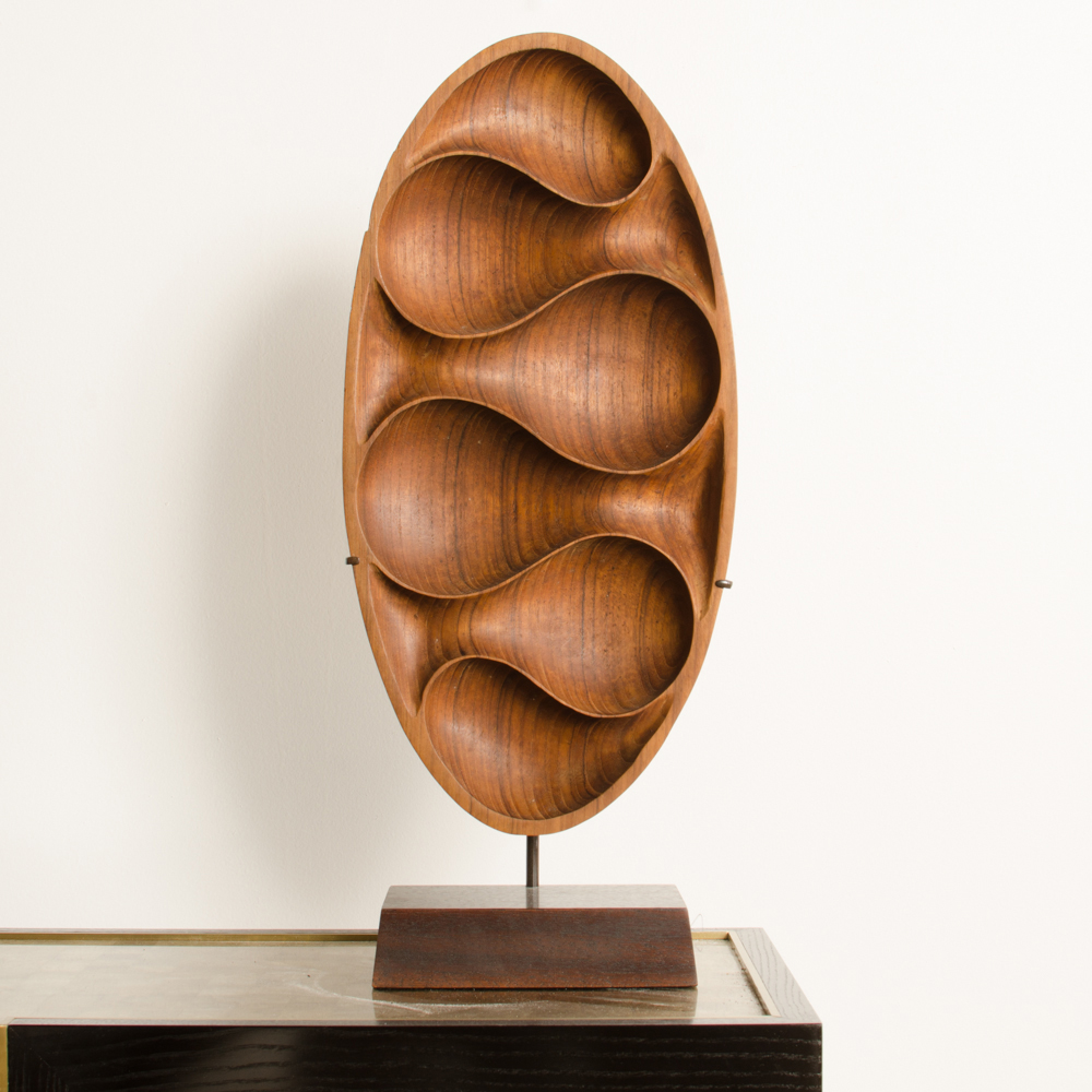 Carved wood almond shaped scuplture and base