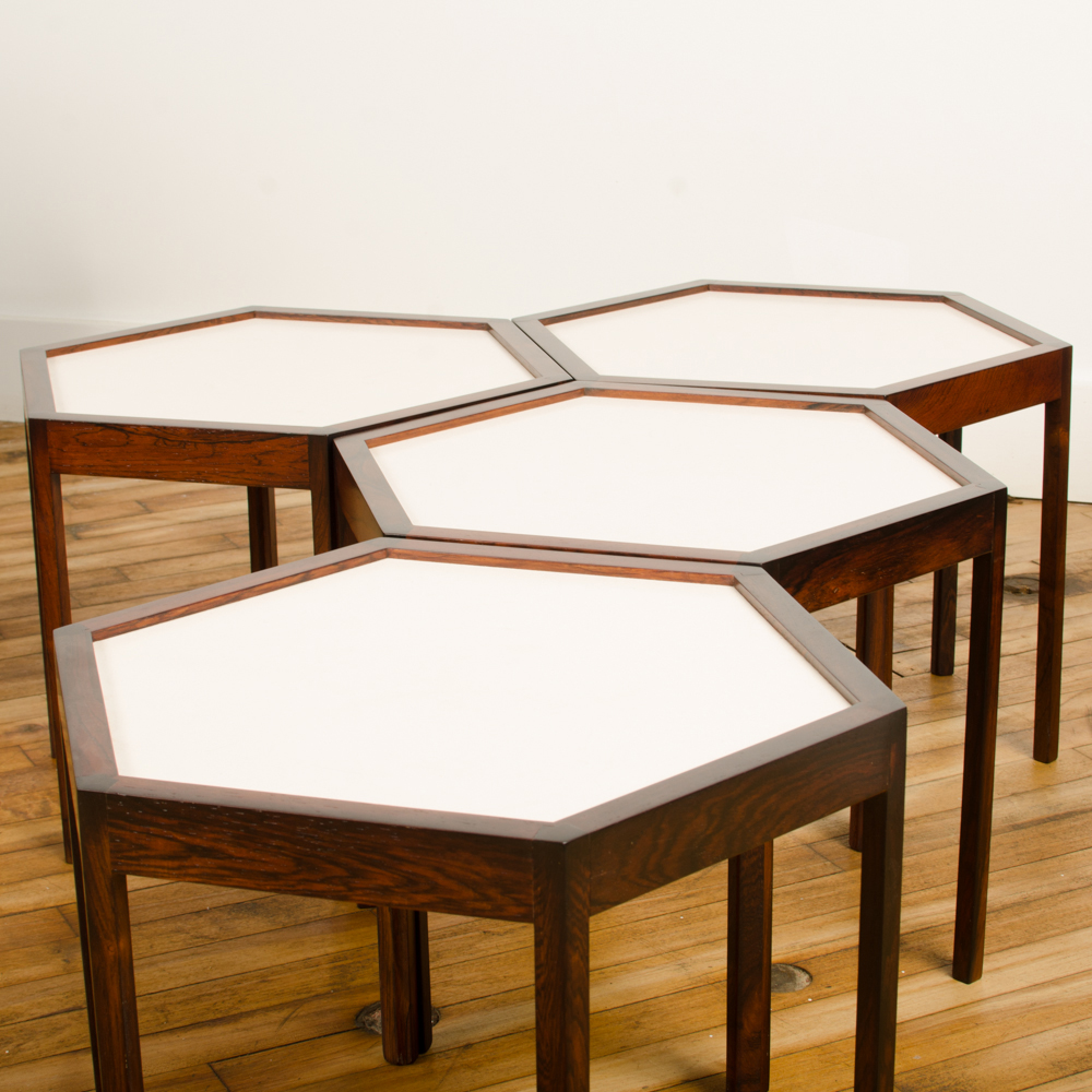 A set of four Danish side tables designed by Hans C Andersen. Hexagon shape with solid rosewood and white laminate top circa 1960.