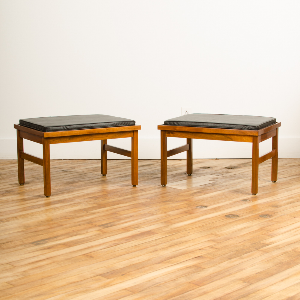 A pair of American of Martinsville small benches, with original leather seats, American, 1950s. Leather cushions have original labels.