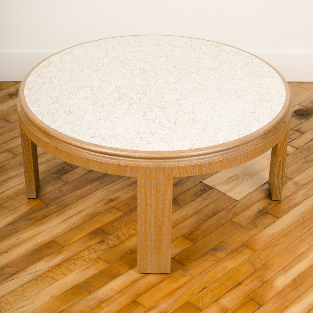 Modernist round cocktail table with eggshell fragment surface.