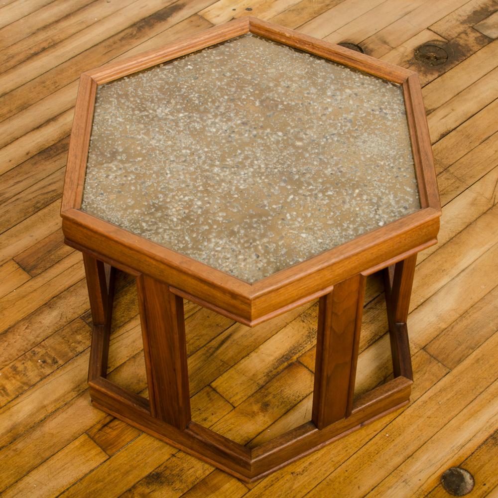 Hexagonal walnut side table with peppled resin design by John Keal