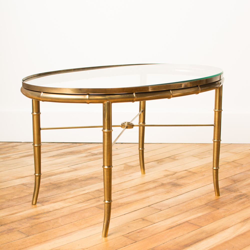 Faux bamboo oval brass table with glass top
