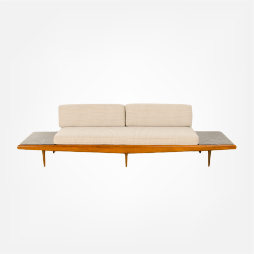 A Mid-Century Modern sofa in the manner of Adrian Pearsall. Walnut with slate inlay end tables. Circa 1950s.