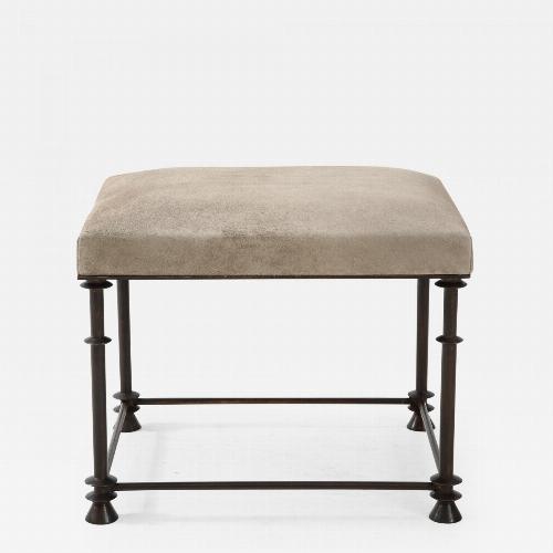 "An elegant bronze stool covered with ""nubuck retourné""."