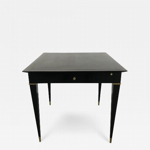 A game table, ebonized mahogany, bronze details and leather top.