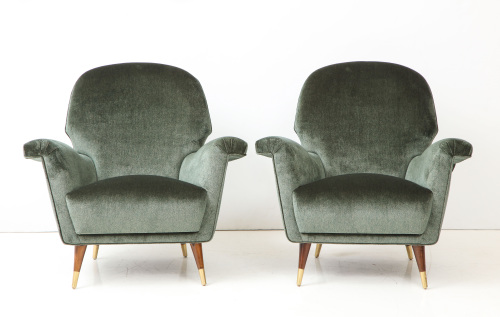 Pair of Mid Century Club Chairs. Walnut legs and brass details.