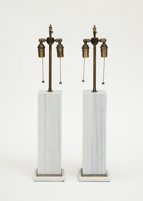 A pair of column shaped lamps