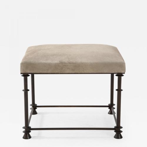 "bronze legged stool covered with ""nubuck retourné""."