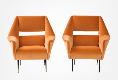 A pair of Gigi Radice upholstered club chairs on iron legs